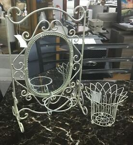 Small mirror stand with flower holder