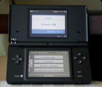 BLACK NINTENDO DSi WITH CHARGER, CARRYING CASE AND GAME