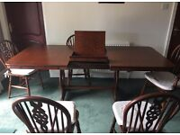 Dining table and 4 chairs plus 2 carvers oak wood