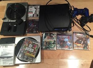 PS3 with DJ Hero, Decks, 2 Controllers, 7 games