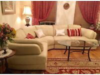 Leather corner sofa. Cream/ivory/ neutral color.