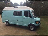 Turquoise blue Mercedes 310 converted van campervan