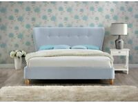King size light blue fabric buttoned bed. New and boxed.