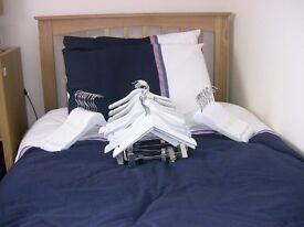 White wooden coat hangers
