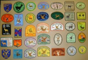 HUNTING CRESTS,PATCHES,OLD FISHING LURES,DEER,BEAR,MOOSE,ELK,MNR