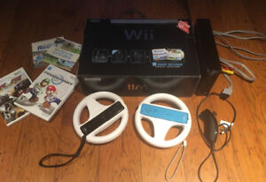 Wii game console + 2 Wii Wheels + games