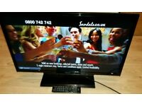 32 inch lcd TV with built in free view complete with remote control