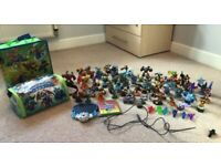 Skylanders massive bundle, incl very rare trap, Xbox supercharge game, portal and storage cases.