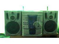 Kenwood compact Hi-Fi system holds 3 cd's,Radio and twin tape decks
