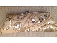Gold sequin evening clutch bag