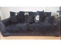 Black fabric sofa and arm chair