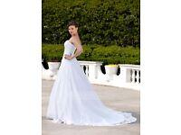 Wedding dress. Never worn change of mind