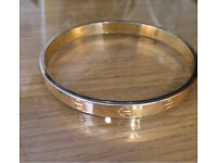 Brand new Gold plated Cartier style bangle