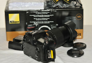 Nikon D7100 24.1 MP DX DSLR with 18-140 lens and  accessories.