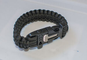 Paracord survival bracelet with whistle and flint striker
