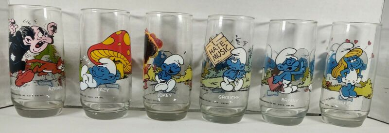 Lot Of 6 different Vintage 1982 Collectible Smurf Glasses. Includes Smurfette.