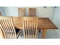 Solid Oak dining table and chairs next