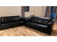 2 black leather seater sofas