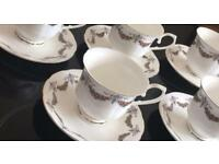 Five china cups and saucers