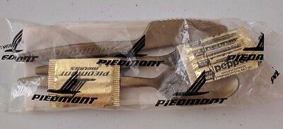Piedmont Airlines gold plastic silverware packets - unopened! Sold in set of 5