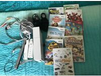 Wii with 9 games and 2 microphones and contollers