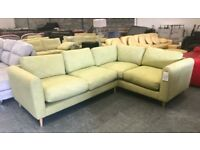 Green fabric corner sofa