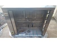Electric rotating vertical grill.NEW