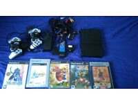 5 PS2 games + 2 PS2 controllers + Broken PS2 with cables