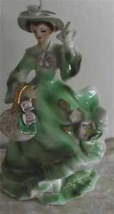 Anart figurine lady with basket of flowers royal doulton stlye