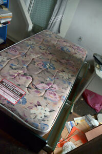 Single size captain's bed with mattress and comforter