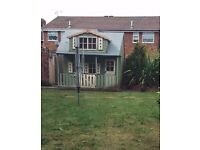 LARGE 2 STORY WOODEN PLAYHOUSE.. Sensible offers considered!