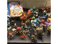 nintendo wii games 2x skylanders & lots figures , cards , books, bag / very good condition