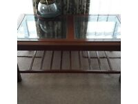 Beautiful wooden and glass coffee table with shelf