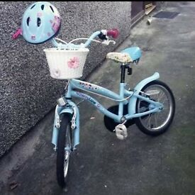 Girls bike for sale. Age 5-8. With matching helmet.