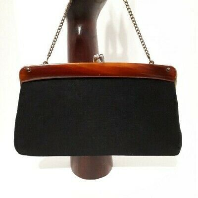 1950s Handbags, Purses, and Evening Bag Styles Black Wool Purse Mid Century with lucite handle kiss lock and chain $29.95 AT vintagedancer.com