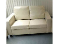 Cream faux leather small two seater sofa