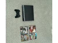 Ps3 slim with 4 games.