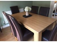 Dining room table with six suede and faux leather chairs