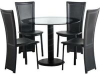Round glass dining table with 4 high back black chairs