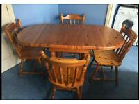 Oval pine table and four chairs
