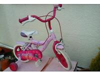 Little girls starter bike with stablezers suit 3ish to 5ish 12inch wheels hardly been used