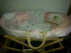 1 Moses basket 2 Stands vests and sleep suits