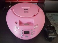 pink bush stereo with cd player and ipod dock