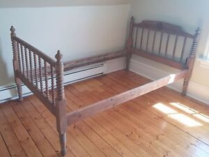 A true antique wooden bed with headboard footboard & rails