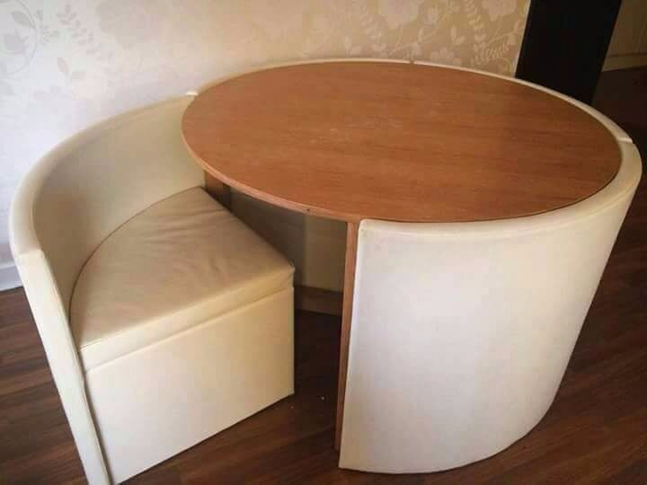 Table With Hidden Chairs round dining table with hidden chairs from next | in bearsden