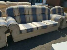 Striped fabric three seater sofa with two matching armchair,s