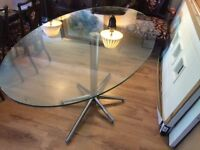 Dwell Stellar glass and chrome dining table