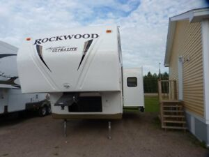 2011 Rockwood 8281SS with bunk house. Half-ton tow-able
