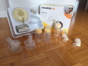 Tire lait swing medela