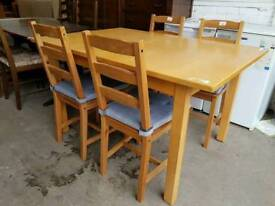 Modern extendable dining table with four chairs